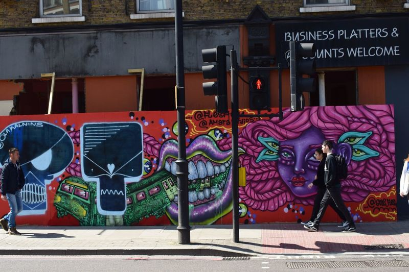London Shoreditch Architecture Art And Craft Arts Culture And Entertainment Building Exterior Built Structure Communication Creativity Day Graffiti Leisure Activity Lifestyles Multi Colored One Person Outdoors Real People Representation Text Western Script