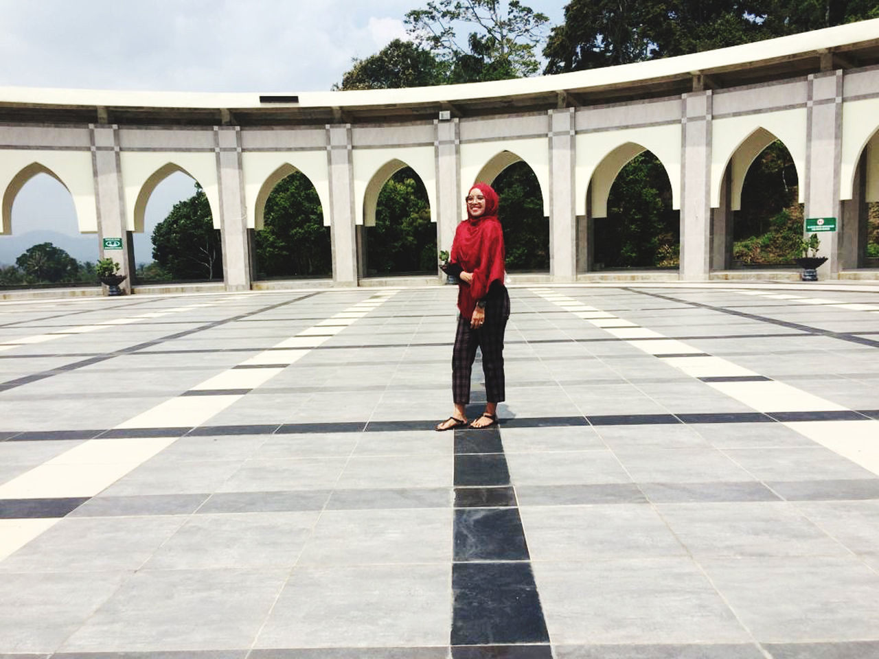 full length, architecture, one person, real people, arch, built structure, lifestyles, standing, day, rear view, walking, casual clothing, leisure activity, women, adult, red, clothing, tiled floor, nature, outdoors, architectural column, warm clothing
