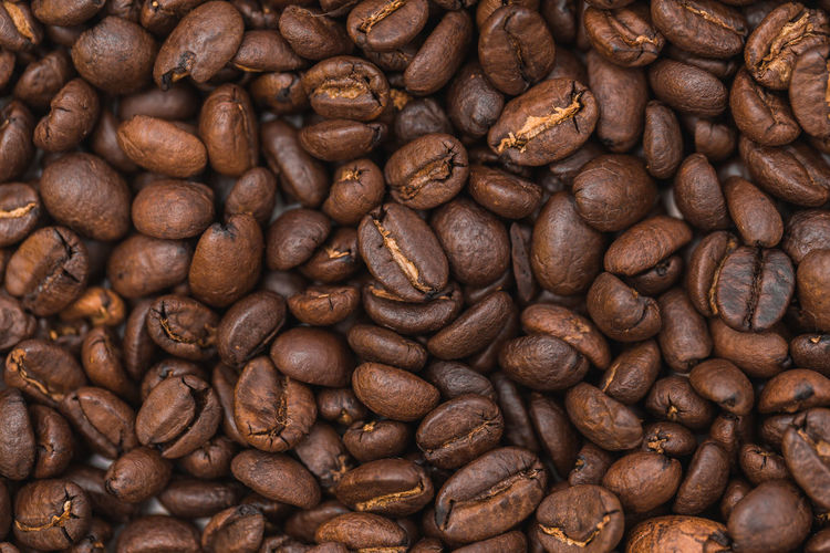 Roasted coffee beans as background Abundance Backgrounds Brown Close-up Coffee - Drink Coffee Bean Day Food Food And Drink Freshness Full Frame Group Of Objects Indoors  Large Group Of Objects Mocha No People Raw Coffee Bean Roasted Roasted Coffee Bean Still Life