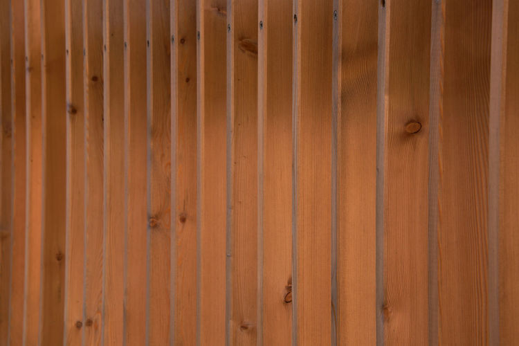 View along a stylish modern timber fence/ privacy screen - fresh construction, - architectural spaced timber slats/posts Copy Space Home Improvement Modern Privacy Screen Abstract Architectural Backgrounds Brown Close-up Contemporary Contemporary Design Design Fence Fences Outdoors Pattern Posts Privacy Repetition Slats Spaced Texture Textured  Wood - Material Wood Grain