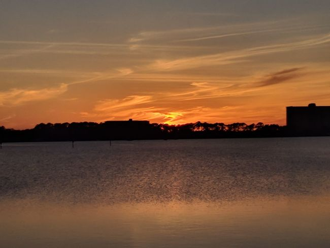 colorful sunset over the water Sunset Reflection Dramatic Sky Beauty In Nature Landscape Scenics Orange Color