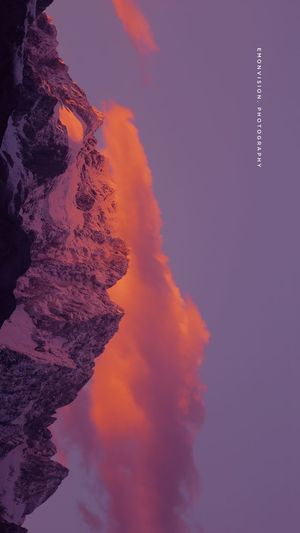 玉龙雪山 Sky No People Beauty In Nature Nature Sunset Orange Color Scenics - Nature Cloud - Sky Tranquil Scene Tranquility Architecture Building Exterior Silhouette Outdoors Built Structure Environment City Low Angle View Purple Water First Eyeem Photo