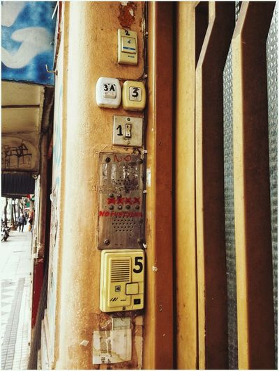 Cual timbre? Portero Timbre Street Pay Phone Communication Text Close-up Telephone Booth Fuse Box Capital Letter