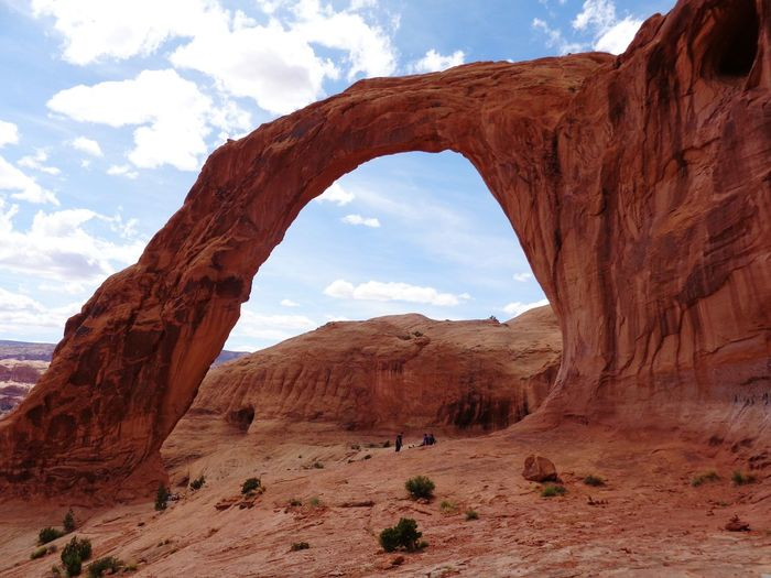 Rock Formation By Mountains At Arches National Park Against Sky