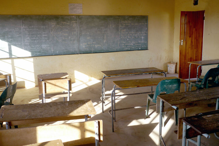 High Angle View Of Empty Benches In Classroom
