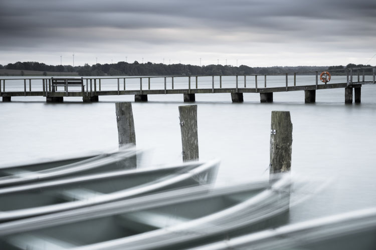 Dancing boats Fresh On Eyeem  Hemmelsdorfer See Schleswig-Holstein The Week On EyeEm Architecture Blurred Motion Boats Bridge - Man Made Structure Built Structure Cloud - Sky Cold Temperature Connection Day Lake Lakeside Nature No People Outdoors River Sky Storm Cloud Water Winter Betterlandscapes An Eye For Travel