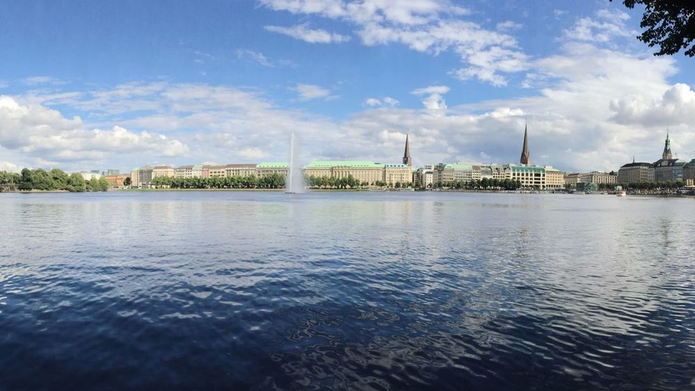 Hamburg Alsterfontäne Alster Water Waterfront Built Structure Architecture Building Exterior Sky Rippled River City Travel Destinations Cloud - Sky Lake Blue Day Tranquil Scene Riverbank Tourism Outdoors Cloud Nature