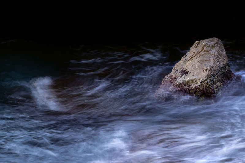Motion Motion Rock Rock - Object No People Solid Water Long Exposure Beauty In Nature Scenics - Nature Blurred Motion Nature Outdoors Sea Rock Formation Backgrounds Tranquility Flowing Water Black Background Aquatic Sport Power In Nature Dynamic Simple Graphic Stream Stream - Flowing Water