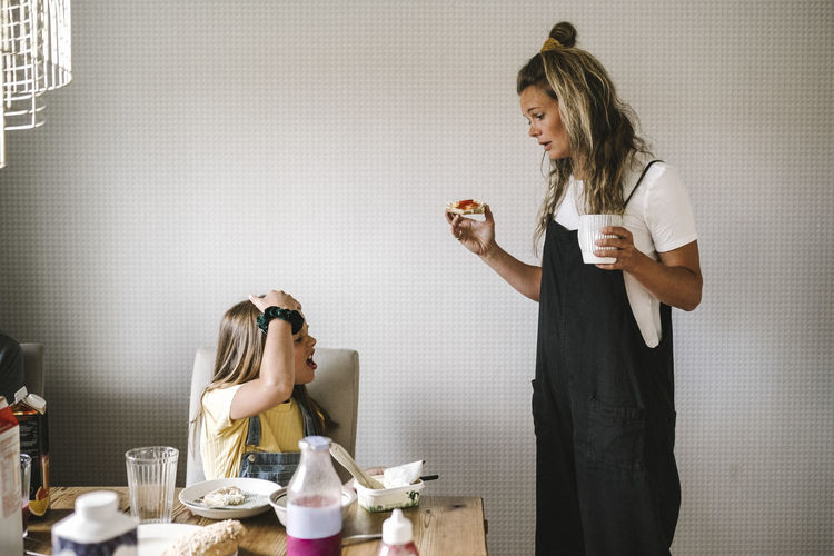 Side view of a woman holding coffee cup