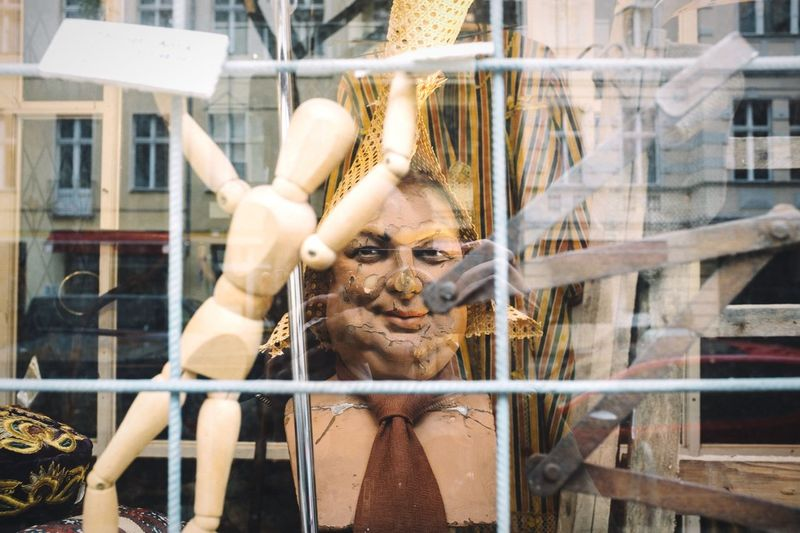 Big brother is watching you Open Edit No People Big Brother Manequin Doll Close-up Selective Focus Depth Of Field Scary Scary Face Man Smile Scary Smile Smiling Face Show Windows Display FujiX100T Objects Showcase April Reflection Window Shopping Toys Captivity ArtWork Art