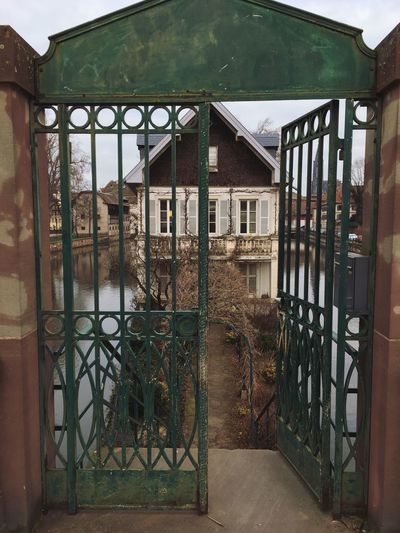 The door is open for you. House By The Water Rectangle Placid  Entrance House Security Door Architecture Built Structure Building Exterior Protection House Entrance Gate Metal Day Entry Outdoors No People