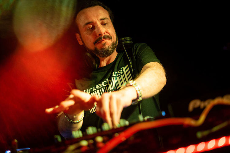 Mature man playing songs at nightclub