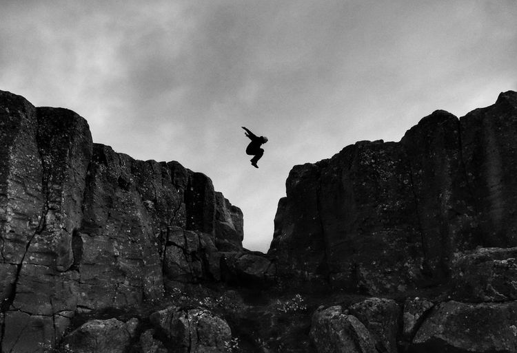 Jumping over a crevice in Iceland Crevice Sony Mid Air Flying Jumping Jump Rock Rock - Object Sillouette Iceland Parkour Freedom Obstacle Fear Blackandwhite Black And White Black & White Stunt Aerobatics