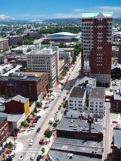 Aerial view of Elm Street and financial buildings in Manchester, New Hampshire Manchester New Hampshire, USA USA Aerial View Architecture Building Exterior Built Structure Car City City Life Cityscape Day High Angle View Land Vehicle No People Outdoors Road Sky Skyscraper Transportation Tree