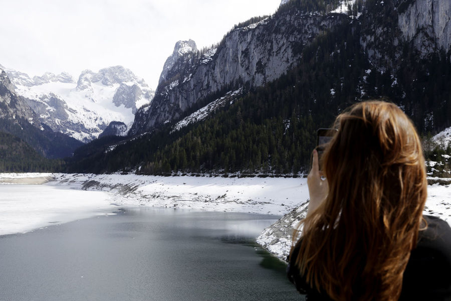 Beauty In Nature Cold Temperature Hair Hairstyle Leisure Activity Lifestyles Long Hair Mountain Nature One Person Outdoors Real People Scenics - Nature Snow Snowcapped Mountain Water Winter Women