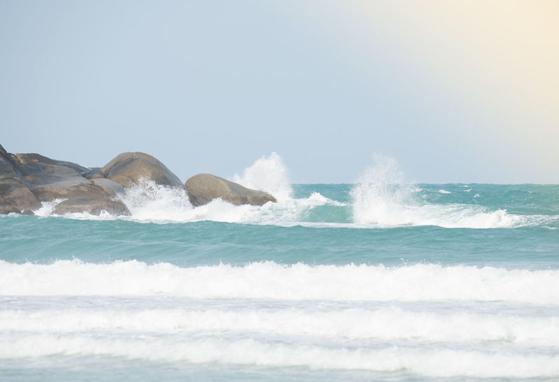 Big waves hitting the rocks at cape kata beach in monsoon season. Travel to the hideaway island,free you soul and enjoy life, travel concept. Big Waves Rock Blue Sky Hideaway Island Hitting Sea Sun Beach Travel Concept Travel Destination Waves Crashing