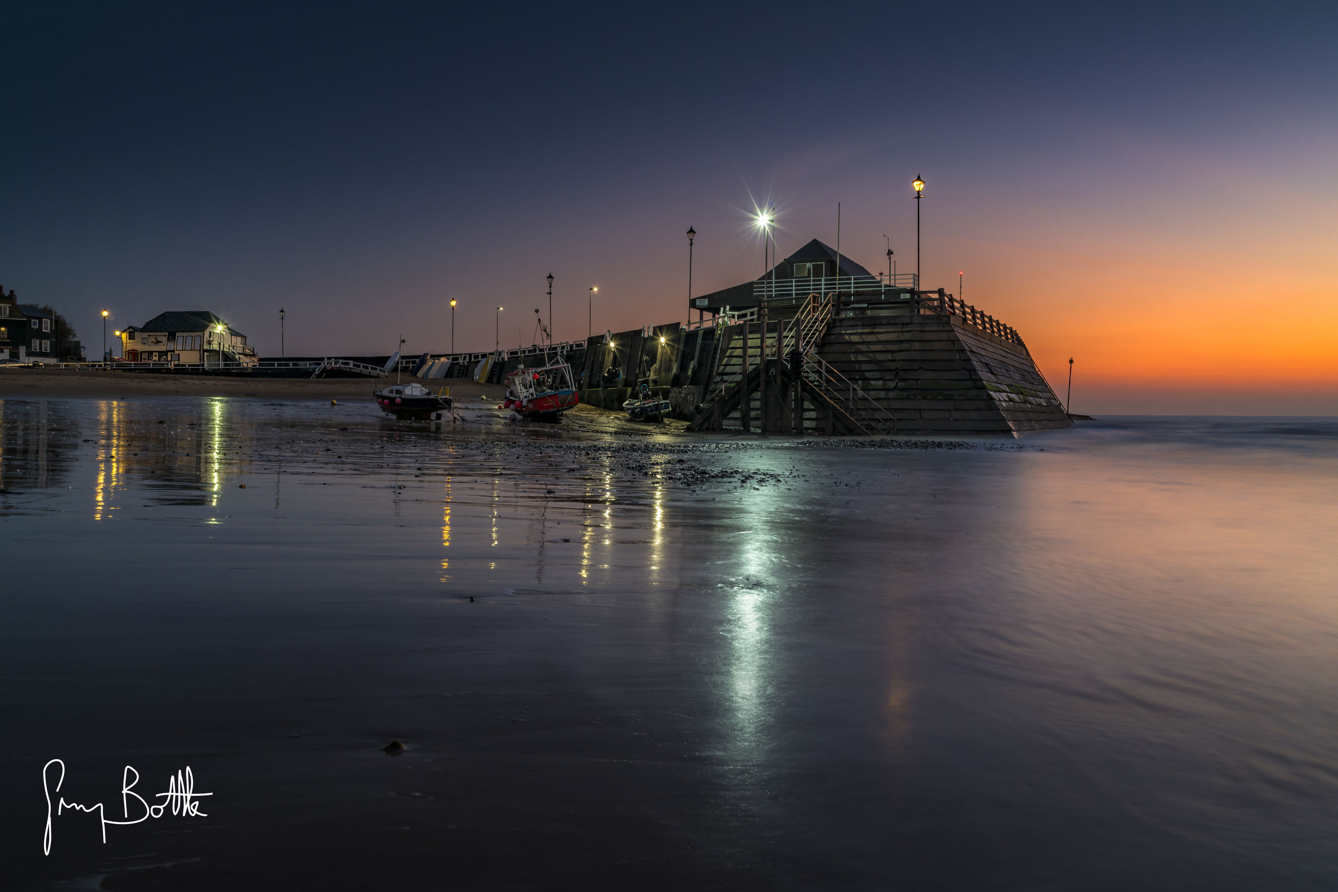 water, sea, illuminated, reflection, architecture, beach, sky, outdoors, building exterior, sunset, no people, nature, night