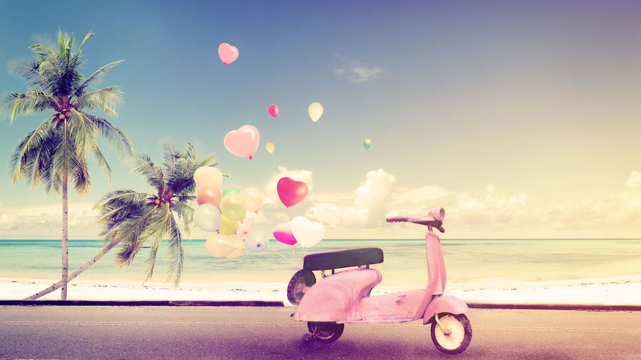 Classic motorcycle with heart balloon on beach blue sky concept of love in summer and wedding honeymoon - vintage color effect Honeymoon Holiday Sea Beach Pink Color Tropical Climate Vacations Summer Trip Balloon Wedding Love Happiness Postcard Romance Romantic Heart Tropical Relaxing Celebration
