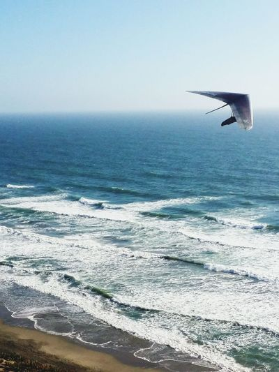 The Color Of Sport Flight Hand Gliding Horizon Over Water