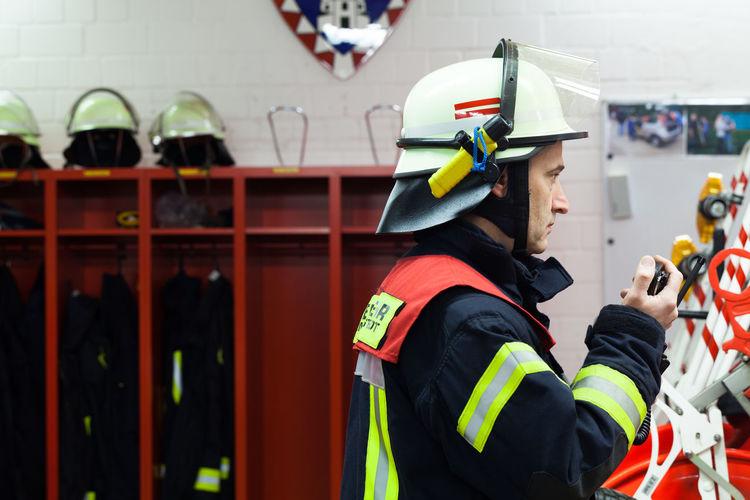 Side View Of Firefighter Wearing Helmet