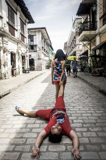 Woman Dragging A Man On The Street