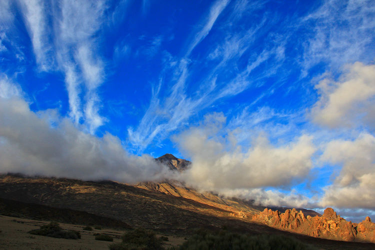 Beauty In Nature Blue Canadas Del Teide Cloud - Sky Cloudy Day Day Desert Landscape Erupting Evening Light Landscape Nature No People Outdoors Physical Geography Sky Sky And Clouds Smoke - Physical Structure Teide Teide National Park Tenerife