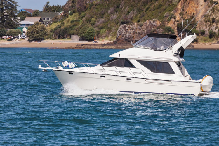 Motor yacht in Bay of Islands, New Zealand Bay Of Islands Boating Coastline Driving Paihia Racing Boat Vacations Boat Boats Close-up Cruising Full Length Motor Yacht Motorboat Nautical Vessel New Zealand One Person Sea Side View Speedboat Unrecognizable Person Water White Yacht Yachting