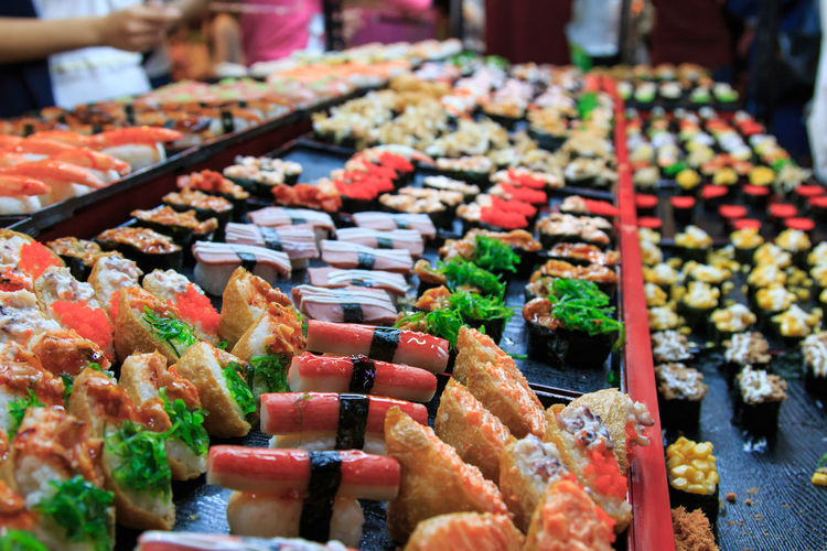 High Angle View Of Sushi Arranged At Market Stall