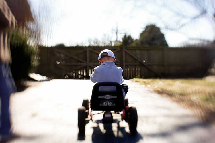 Young Boy Riding Go Cart Outside With Blurry Background Real People Ride Day Gocart Go Cart Childhood Boy Kids Outdoors Winter Lensbaby  Lensbaby Sol45 Selective Focus Kid Childhood Memories