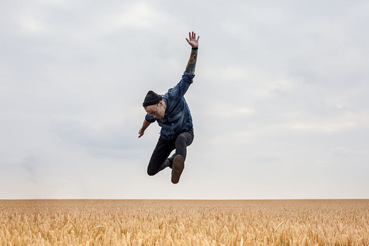 People Jumping Peoplephotography People Of EyeEm Jumping Shot Field Freedom Happiness Happy Happy People Tattoo Tattooed Drummer Fieldscape Fields Of Gold Enjoyment Fan Jumping For Joy Jump Horizontal Horizontal Symmetry Horizon Over Land