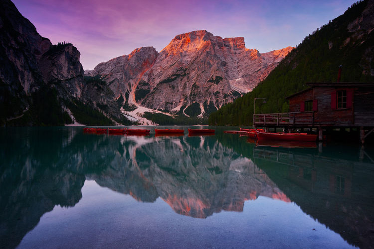 Lago Di Braies, Italy Beauty In Nature Eroded Formation Idyllic Italy Lago Di Braies Lake Mountain Mountain Peak Mountain Range Nature No People Non-urban Scene Outdoors Pragser Wildsee Reflection Rock Rock Formation Scenics - Nature Sky Standing Water Tranquil Scene Tranquility Water Waterfront