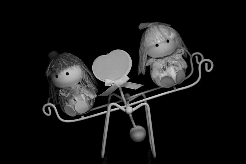 Black And White Black Background Boy And Girl Children Close Up Doll Figurine  Light Box Light Tent Low Key Miniature Playing See Saw Still Life Toy