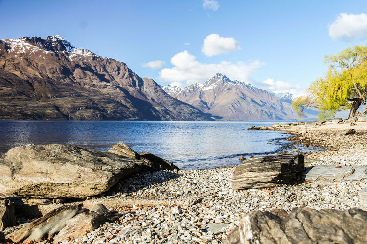 Lake in Queenstown New Zealand Wanaka Queenstown Queenstown Nz Queenstown Newzealand Water Sky Rock Mountain Beauty In Nature Nature Solid Rock - Object Scenics - Nature Cloud - Sky Day Tranquil Scene Tranquility Sunlight Lake No People Landscape Outdoors Environment Mountain Peak