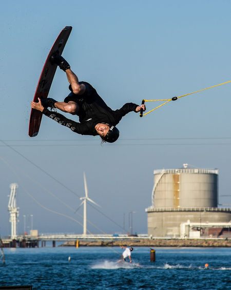 Acrobatic Activity Adventure Brave Cablepark Clear Sky Day Extreme Sports Full Length High Jumping Leisure Activity Lifestyles Men Mid-air Nature One Person Outdoors Performance Real People RISK Skill  Sport Stunt Urban Water