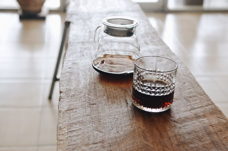 Cold Drink Photographer Cafe Coffee Still Life Table Indoors  Glass - Material High Angle View No People Food And Drink Glass Focus On Foreground Household Equipment Drink Container Drinking Glass Transparent Refreshment Close-up Bottle Day Wood - Material