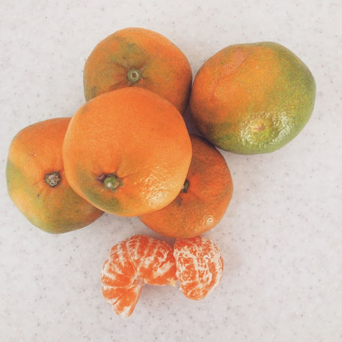 Ripe tangerine fruits top view Above Citrus  Food Food And Drink Freshness Fruit Half Healthy Eating Mandarine Orange Organic Ripe Section Table Tangerine Top View