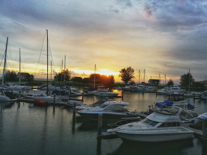 sunset at decks Water Nautical Vessel Yacht Harbor Sunset Moored Sailboat City Sailing Ship Sky Marina Tall Ship Recreational Boat Rigging Pedal Boat Water Vehicle Sailing Boat Sailing Passenger Craft Anchored Dock Motorboat Mast Office Building Fishing Boat River Boat Waterfront Settlement Arch Bridge