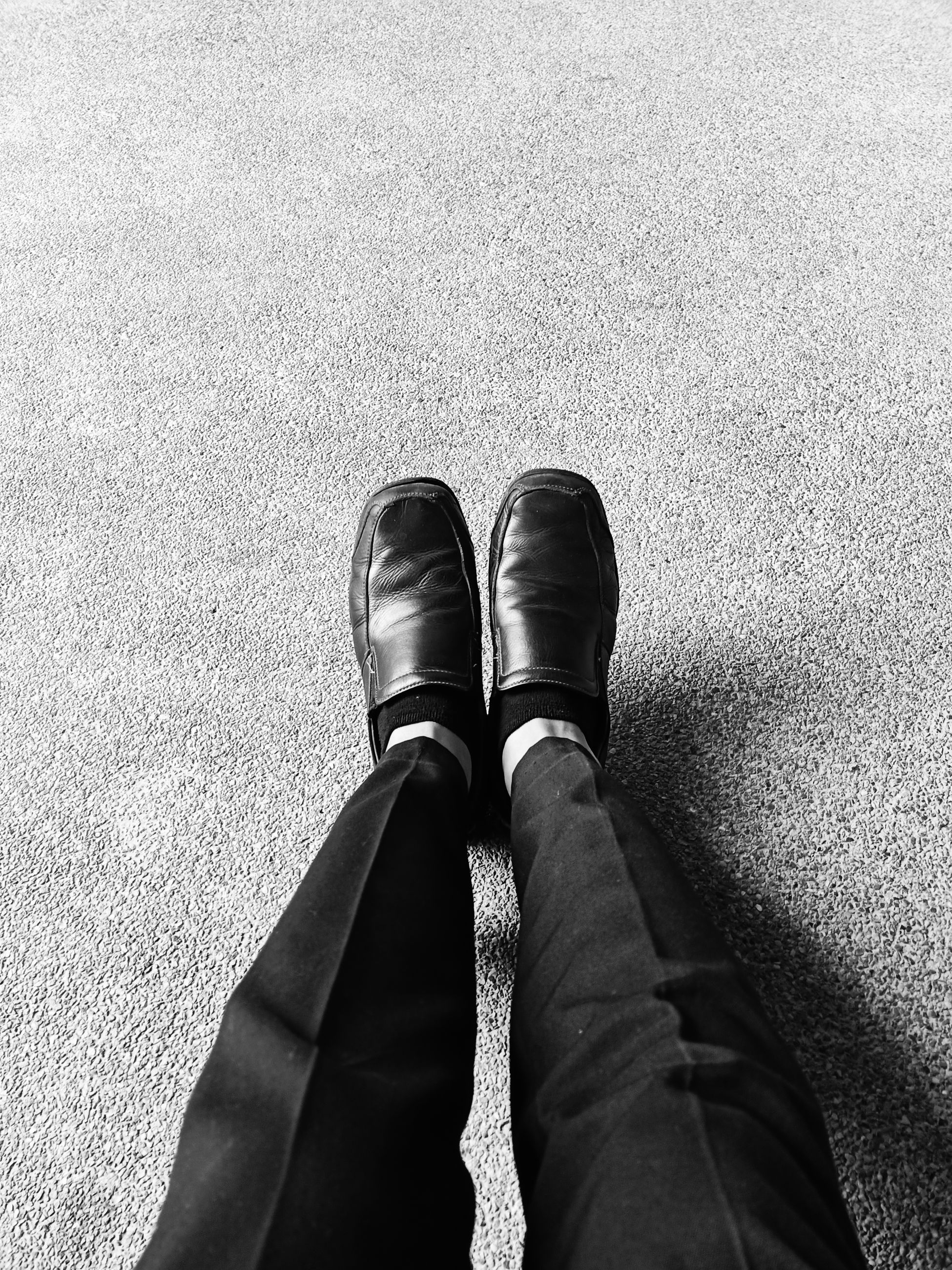 shoe, human leg, low section, one person, personal perspective, body part, real people, high angle view, standing, human body part, lifestyles, day, men, human foot, leisure activity, directly above, outdoors, sunlight, clothing, leather