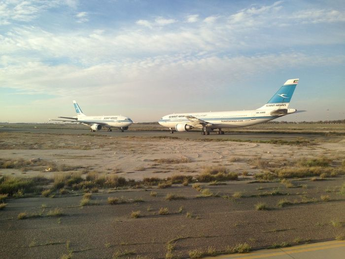 Aerospace Industry Air Vehicle Airplane Airport Airport Runway Cloud - Sky Day Flying Kuwait Airport  Kuwait Airways Landscape Mode Of Transport No People Outdoors Private Airplane Propeller Airplane Sky Transportation