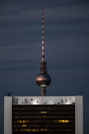 Fernsehturm against sky at night