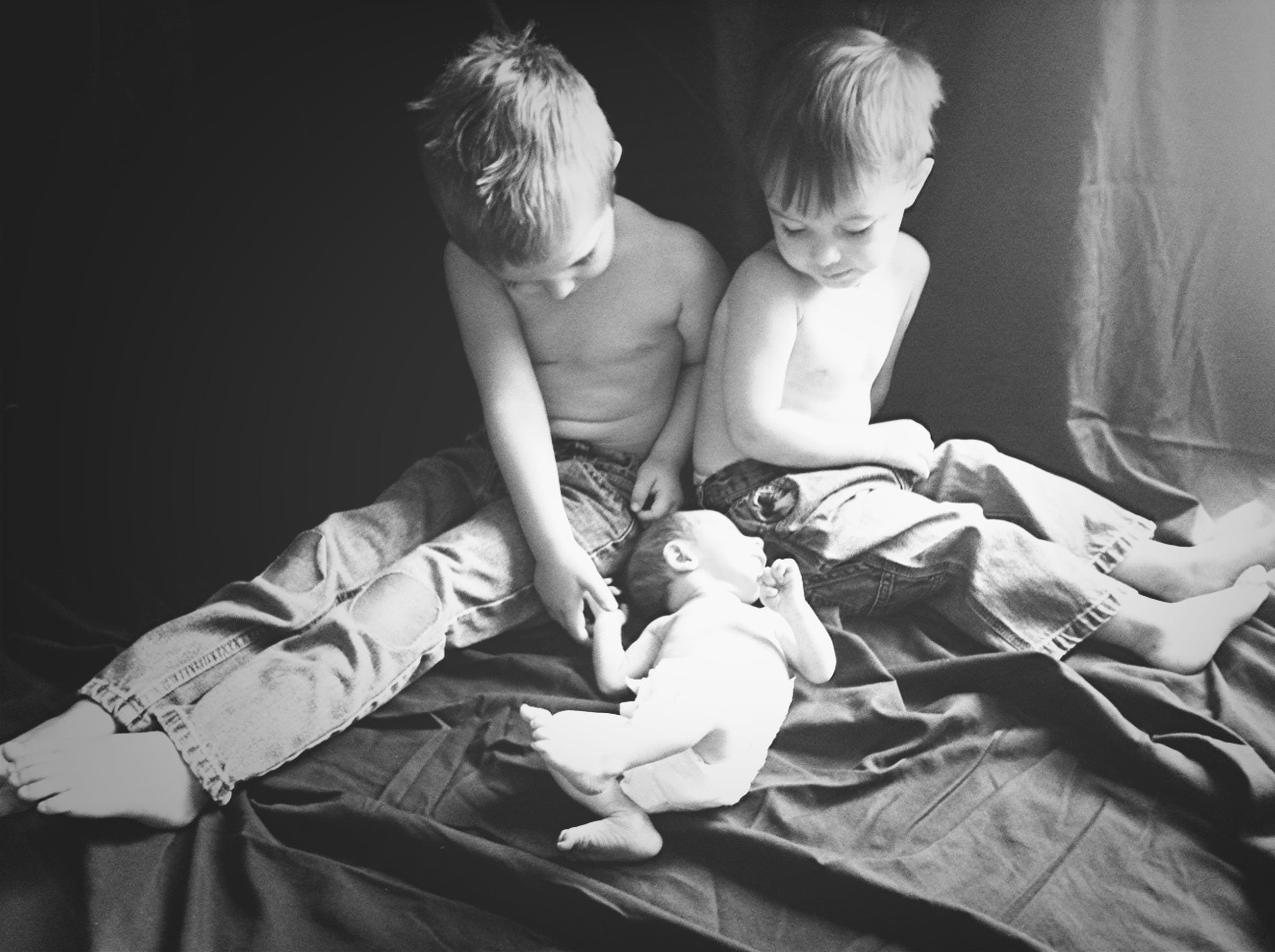 childhood, indoors, togetherness, bonding, lifestyles, person, casual clothing, love, boys, elementary age, leisure activity, holding, innocence, family, baby, sitting, toddler