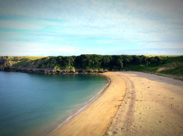 Tranquil Scene Beach Idyllic Non-urban Scene Sea Shore Remote Outdoors Coastline Coastal Coast Pembrokeshire Wales Barafundle Bay Summer Dusk Beauty In Nature Beach Photography Sea And Sky Summer ☀ Tranquility Perfect Green Color 2016 Sky
