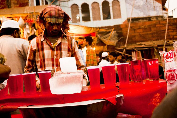 Vendor selling soft drinks in market