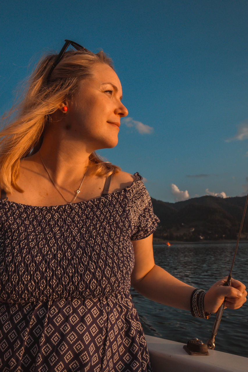 young adult, one person, real people, beautiful woman, leisure activity, young women, water, sky, standing, lifestyles, sea, outdoors, blond hair, nautical vessel, day, close-up