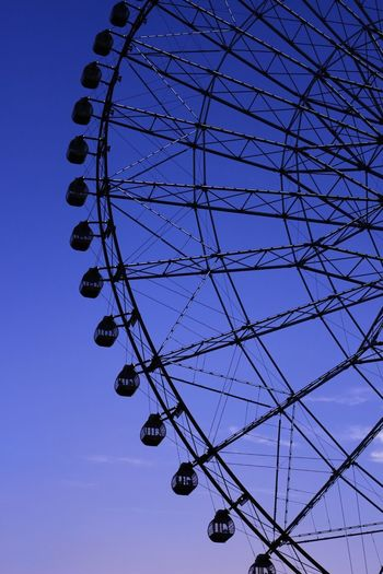 Low Angle View Arts Culture And Entertainment Ferris Wheel Amusement Park Sky No People Day Blue Clear Sky Amusement Park Ride Big Wheel Outdoors