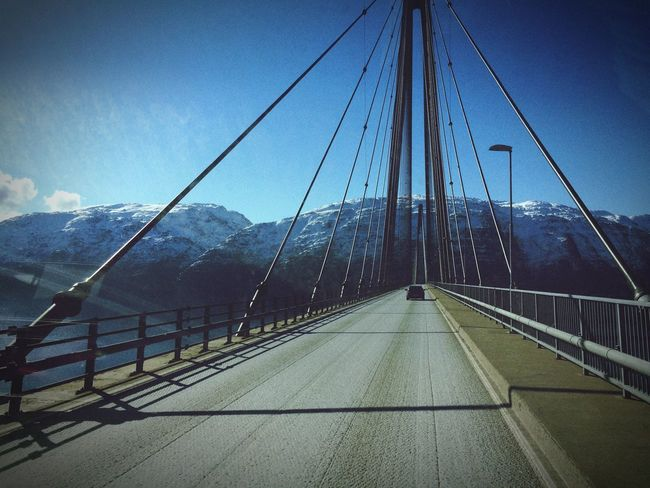 Mountain Transportation Connection The Way Forward Cable Bridge - Man Made Structure Railing Outdoors Sky Day Suspension Bridge Road Mountain Range Built Structure Travel Destinations Cold Temperature No People Winter Snow Scenics