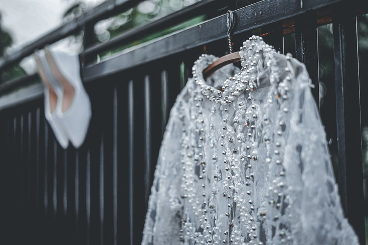 Close-up of clothes hanging on window at store
