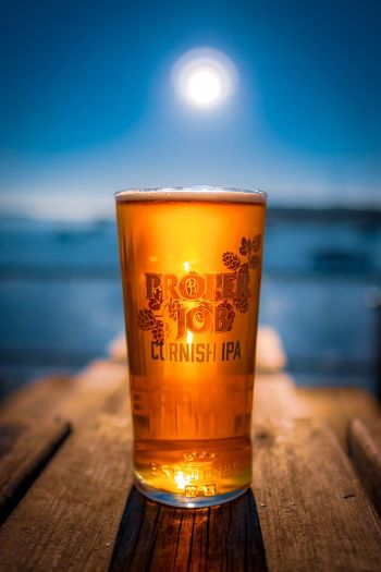 EyeEm Selects Refreshment Beer Beer - Alcohol Food And Drink Drink Glass Alcohol Sky Table Drinking Glass No People Beer Glass Sea Glass - Material Water Beach Household Equipment Wood - Material Focus On Foreground