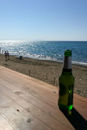 sea , sun and beer what else Water Wave Sea Beach Alcohol Drink Sand Shadow Bottle Clear Sky My Best Travel Photo A New Perspective On Life