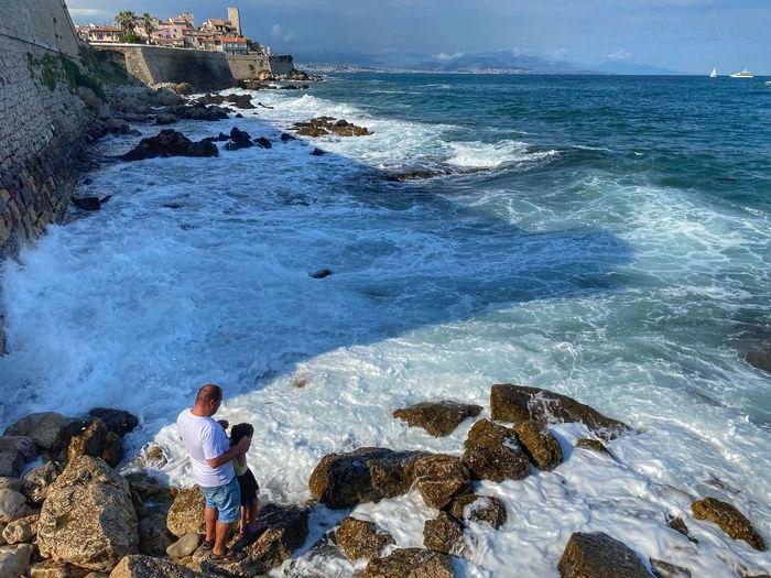 Man looking at sea shore